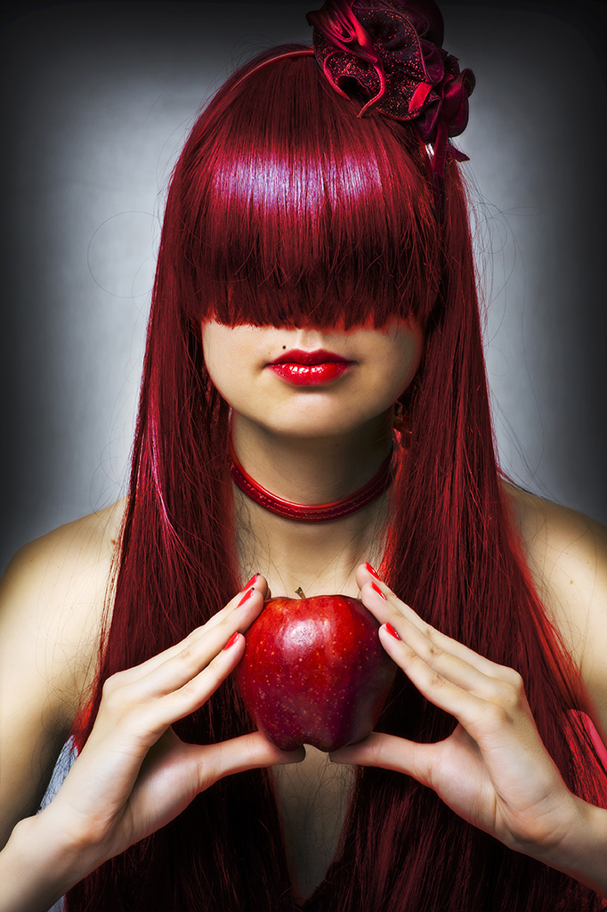Redhead holding apple